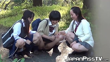 Voyeur catches kinky Japanese schoolgirls pissing in public